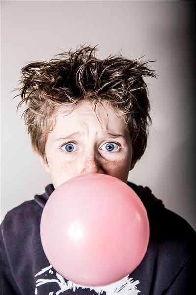 Boy Blowing Bubble Gum
